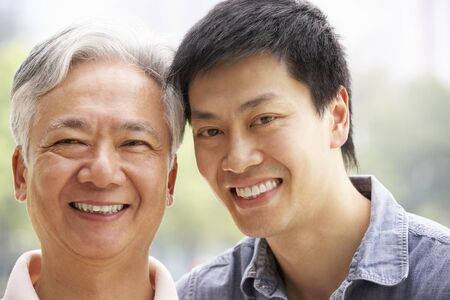 Portrait Of Chinese Father With Adult Son In Park Stock Photo - 18710468