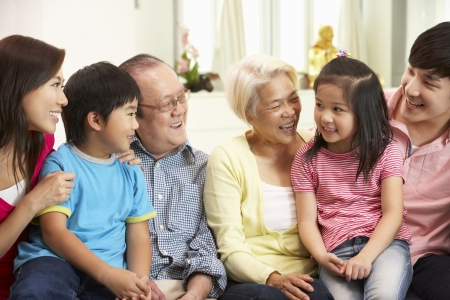 Portrait Of Multi-Generation Chinese Family Relaxing At Home Together photo