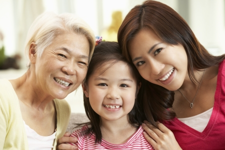 three generations of women: Female Multi Genenration Chinese Family Group Relaxing At HomeTogether