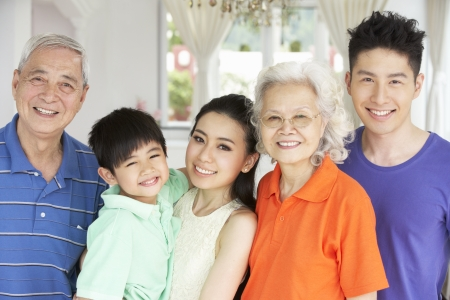 three generations: Portrait Of Multi-Generation Chinese Family Relaxing At Home Together