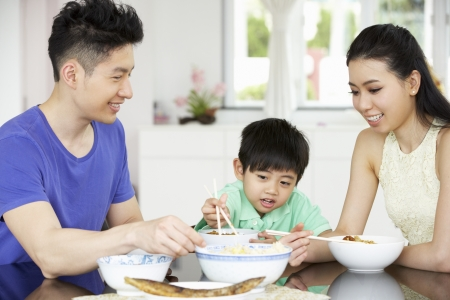 rice noodles: Chinese Family Sitting At Home Eating A Meal
