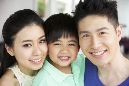 chinese family: Head And Shoulders Portrait Of Chinese Family Together At Home Stock Photo