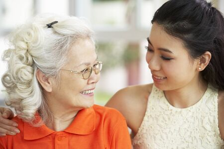 Portrait Of Chinese Mother With Adult Daughter Relaxing At Home Stock Photo - 18710452