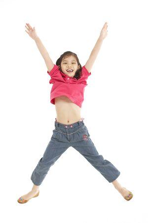 niños chinos: Foto de estudio de la chica chino saltando en el aire