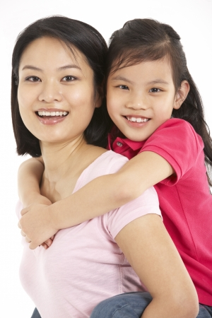 Studio Shot Of Chinese Mother And Daughter Stock Photo - 18709840