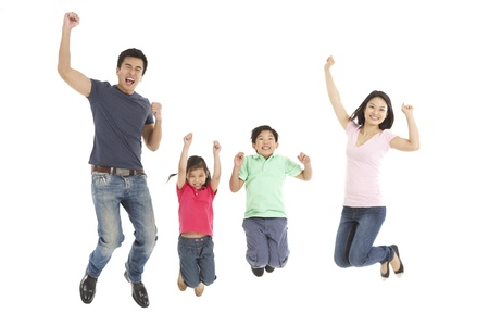 happy people jumping: Studio Shot Of Chinese Family Jumping In Air