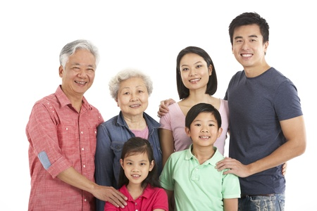 3 generation: Studio Shot Of Multi-Generation Chinese Family Stock Photo