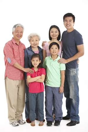happy family asian: Full Length Studio Shot Of Multi-Generation Chinese Family
