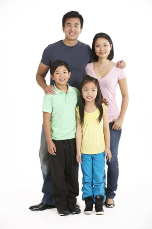chinese family: Full Length Studio Shot Of Chinese Family Stock Photo