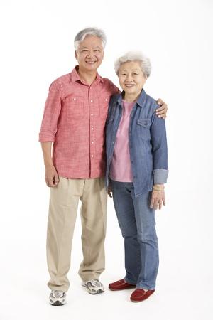 senior asian: Full Length Studio Shot Of Chinese Senior Couple Stock Photo