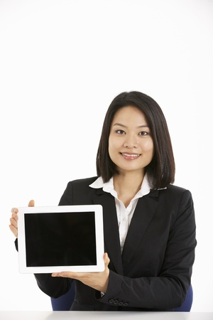 Studio Shot Of Chinese Businesswoman Working On Tablet Computer Stock Photo - 18709395