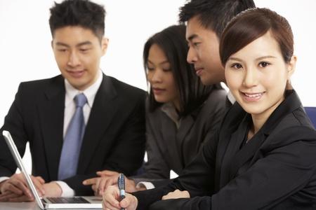 Studio Shot Of Chinese Businesspeople Having Meeting Stock Photo - 18709426