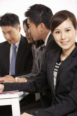 Studio Shot Of Chinese Businesspeople Having Meeting Stock Photo - 18709463