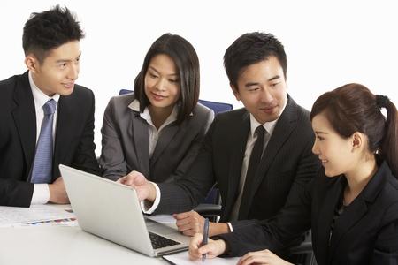 Studio Shot Of Chinese Businesspeople Having Meeting Stock Photo - 18709430