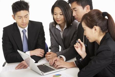 Studio Shot Of Chinese Businesspeople Having Meeting Stock Photo - 18709442
