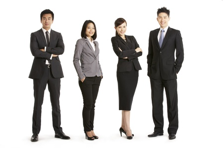 business attire: Full Length Studio Portrait Of Chinese Business Team Stock Photo