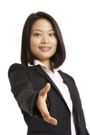 Studio Portrait Of Chinese Businesswoman Reaching Out To Shake Hands Stock Photo - 18709298