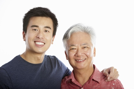 Studio Portrait Of Chinese Father With Adult Son photo