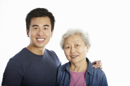 Studio Portrait Of Chinese Mother With Adult Son photo