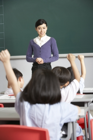 asian teacher: Teacher With Students In Chinese School Classroom