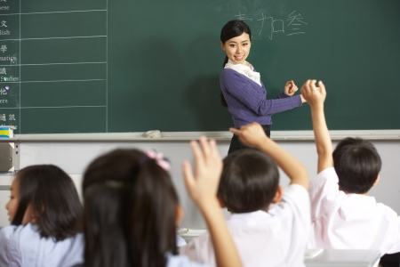 Teacher With Students In Chinese School Classroom photo