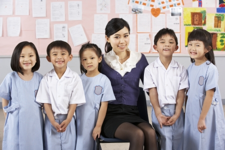 Portait Of Teacher And Students In Chinese School Classroom photo