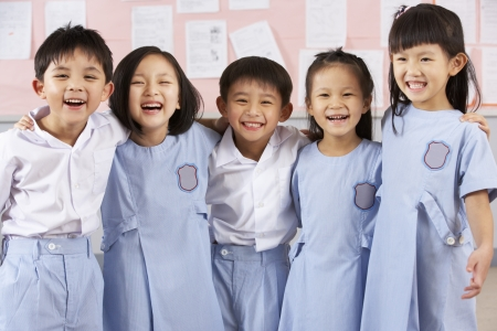 school year: Portait Of Students In Chinese School Classroom Stock Photo