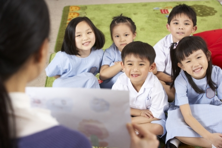 Teacher Showing Painting To Students In Chinese School Classroom photo