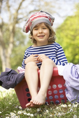 Young Boy Sitting In Laundry Basket Stock Photo - 18709957