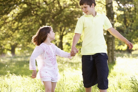 10 year old: Boy And Girl Running Through Summer Field Together