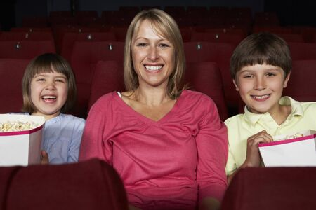 5 10 year old girl: Mother Watching Film In Cinema With Two Children