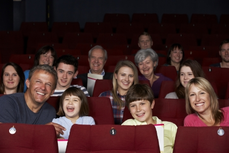 Family Watching Film In Cinema photo