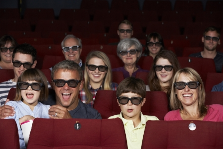 Family Watching 3D Film In Cinema photo