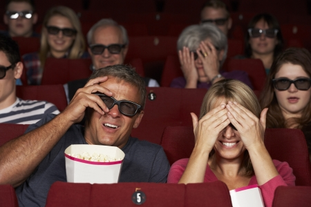 Couple Watching 3D Film In Cinema photo