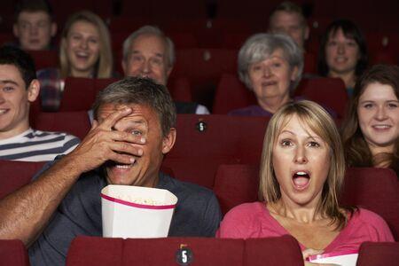 Couple Watching Film In Cinema photo