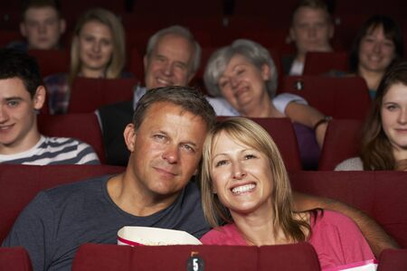 Couple Watching Film In Cinema photo