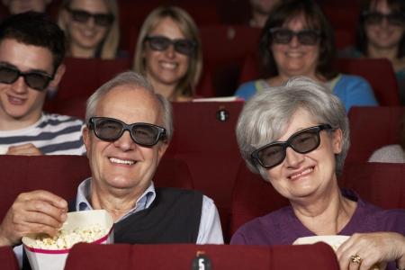 3d film: Senior Couple Watching 3D Film In Cinema