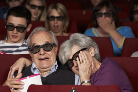 Senior Couple Watching 3D Film In Cinema photo