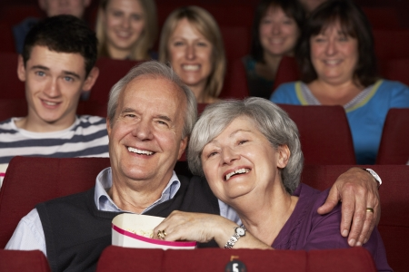 70s adult: Senior Couple Watching Film In Cinema