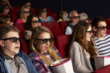 Group Of Teenage Friends Watching 3D Film In Cinema photo