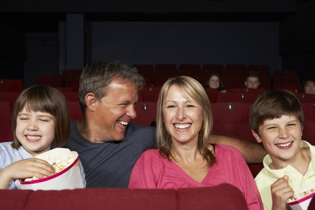 5 10 year old girl: Family Watching Film In Cinema