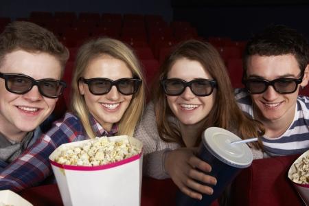 Group Of Teenage Friends Watching 3D Film In Cinema photo