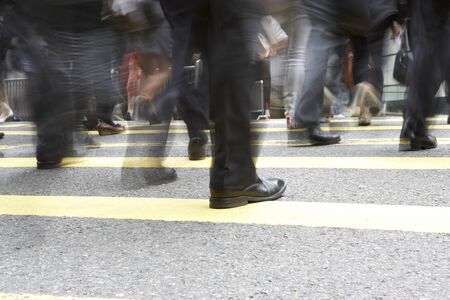 incidental people: Close Up Of Commuters Feet Crossing Busy Hong Kong Street