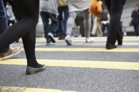pedestrian crossing: Close Up Of Commuters Feet Crossing Busy Hong Kong Street