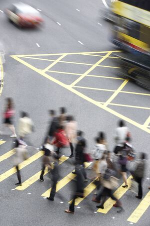 incidental people: Overhead View Of Commuters Crossing Busy Hong Kong Street
