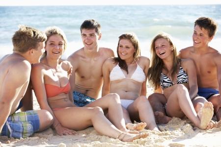 bikini couple: Group Of Teenage Friends Enjoying Beach Holiday Together