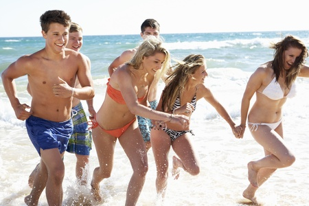 teen beach: Group Of Teenage Friends Enjoying Beach Holiday Together
