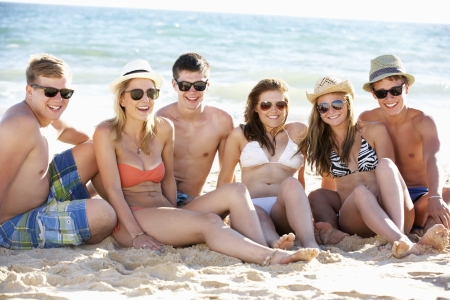 17 year old: Group Of Teenage Friends Enjoying Beach Holiday Together