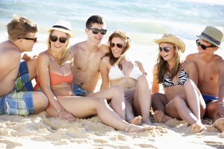 sunglasses beach: Group Of Teenage Friends Enjoying Beach Holiday Together