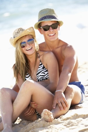 Teenage Couple Enjoying Beach Holiday Together photo